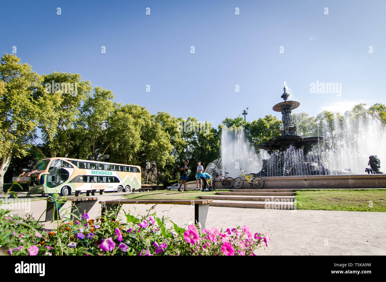 Mendoza, Argentina - April 13th 2019: Kids playing near historical fountain in San Martin National park - Stock Image