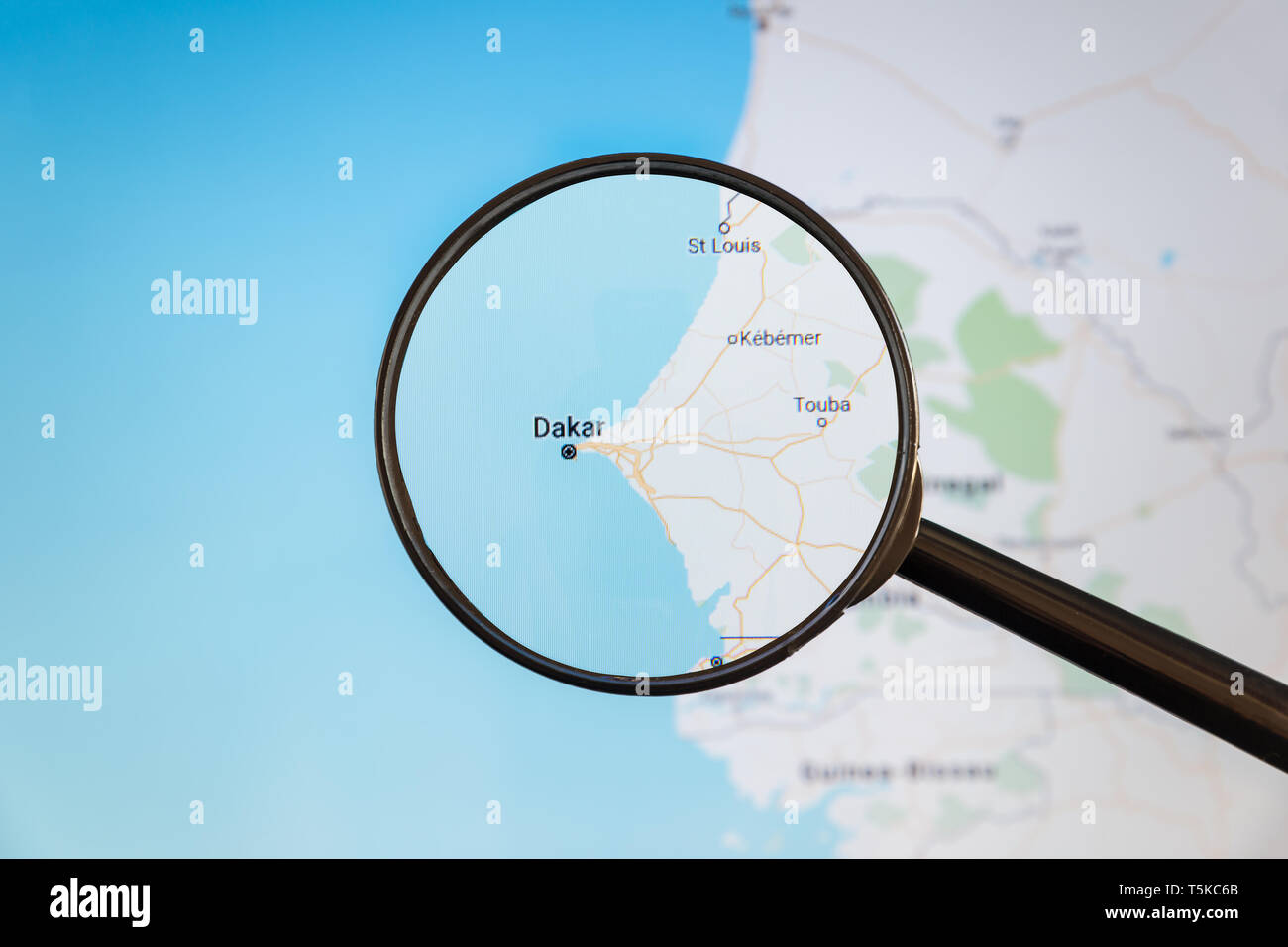 Dakar, Senegal. Political map. City visualization illustrative concept on display screen through magnifying glass. Stock Photo