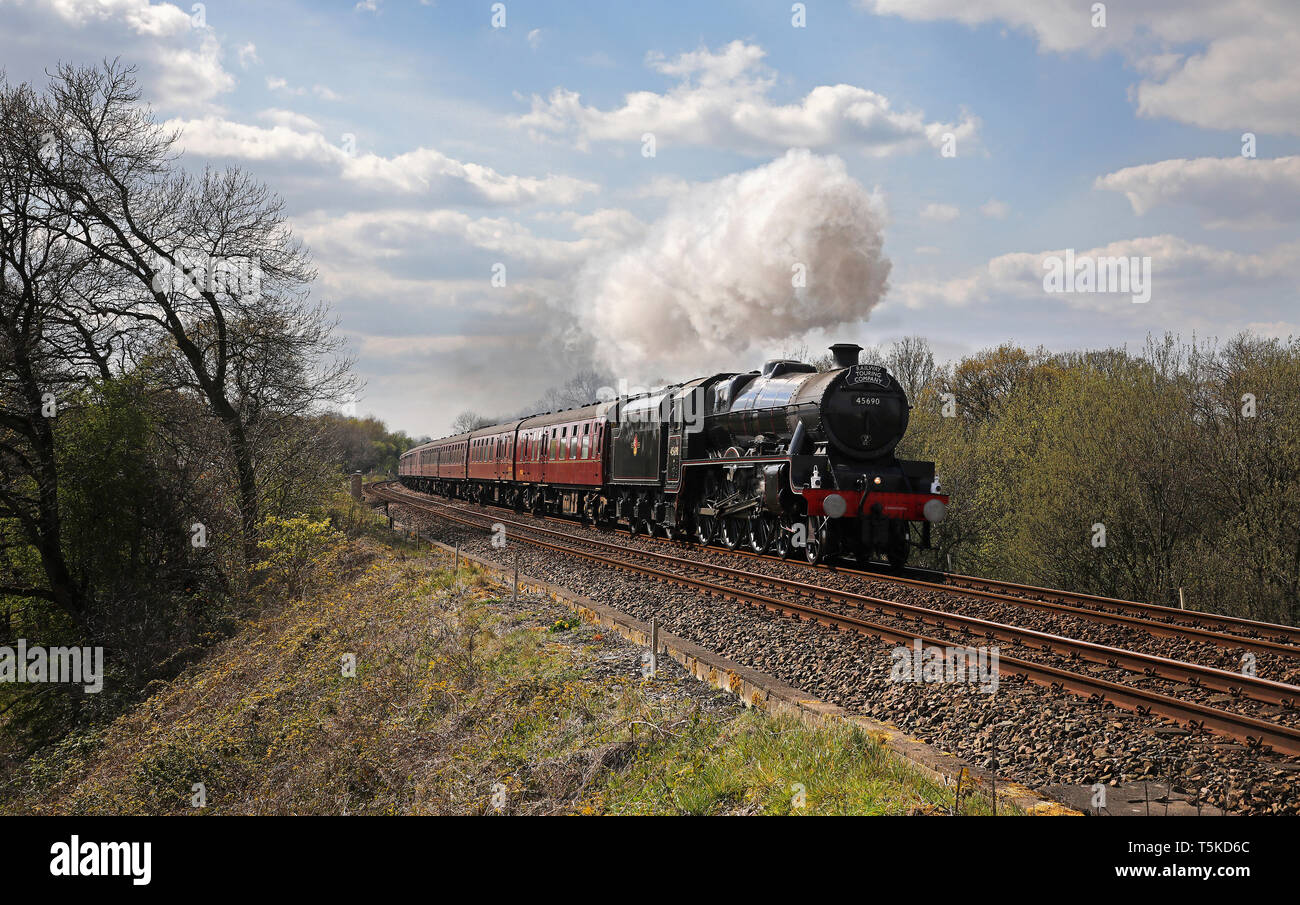 45690 heads past Jack Green with a Blackpool special around the Hellifield circuit. - Stock Image
