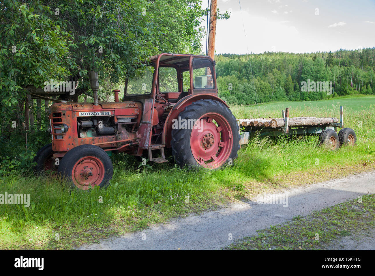 VOLVO BM tractor left beside the road - Stock Image