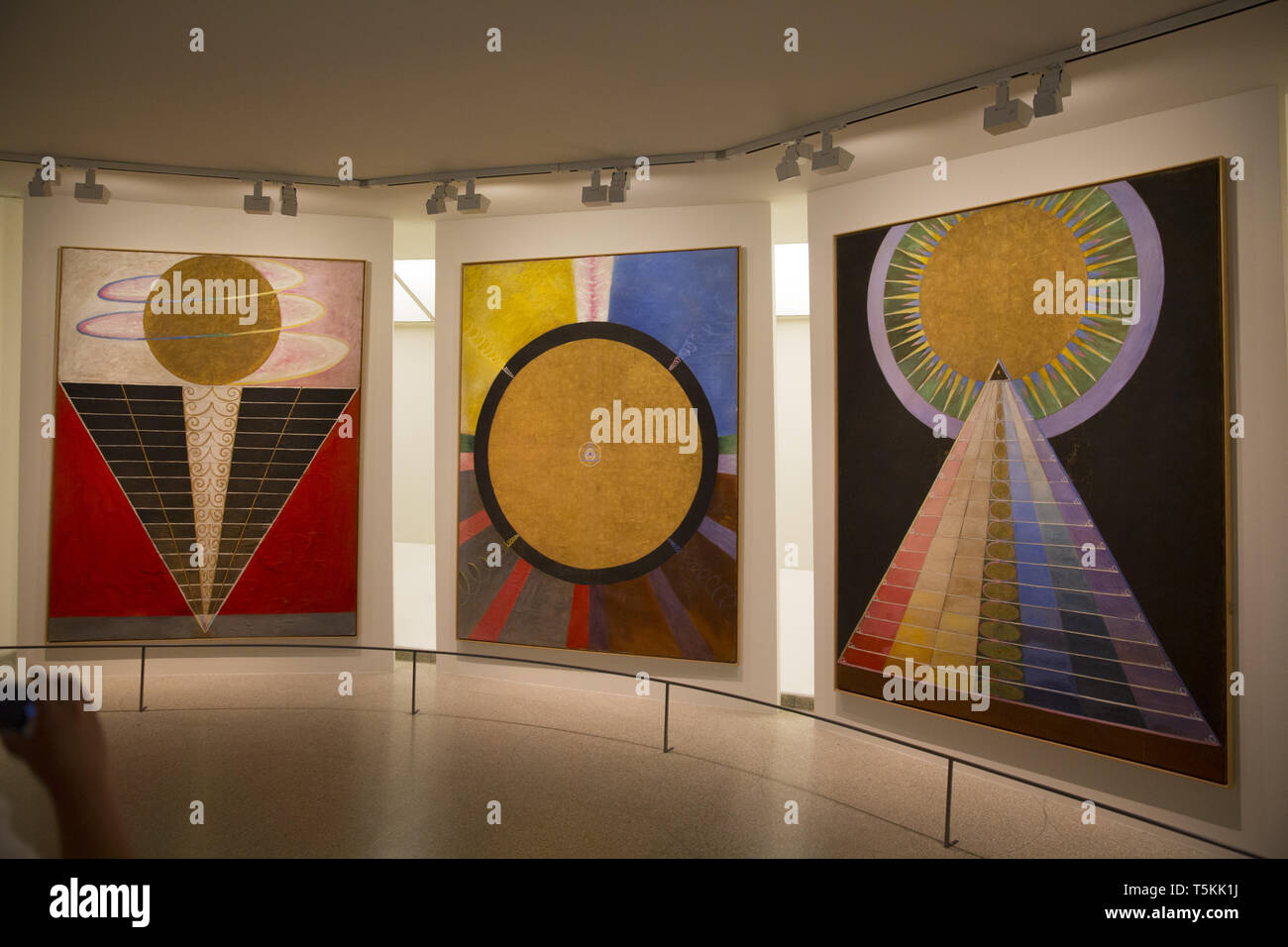 Museum goers at the Guggenheim Museum in New York City view the Hilma af Klint exhibition the most popular show ever at the museum. - Stock Image