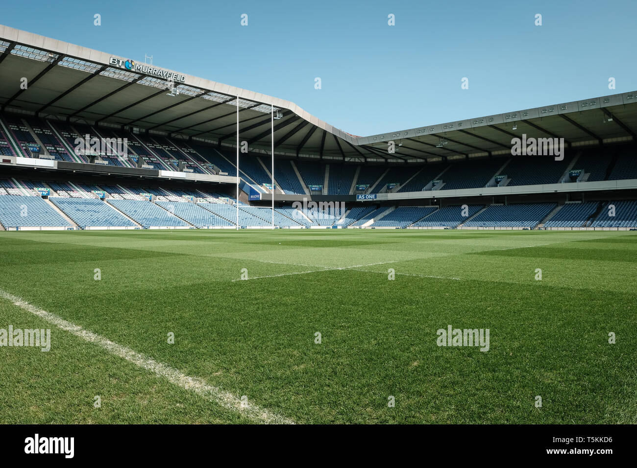 Murrayfield rugby stadium showing the north end stands and goalpost whilst empty on a sunny day, Edinburgh, East Lothian, Scotland - Stock Image
