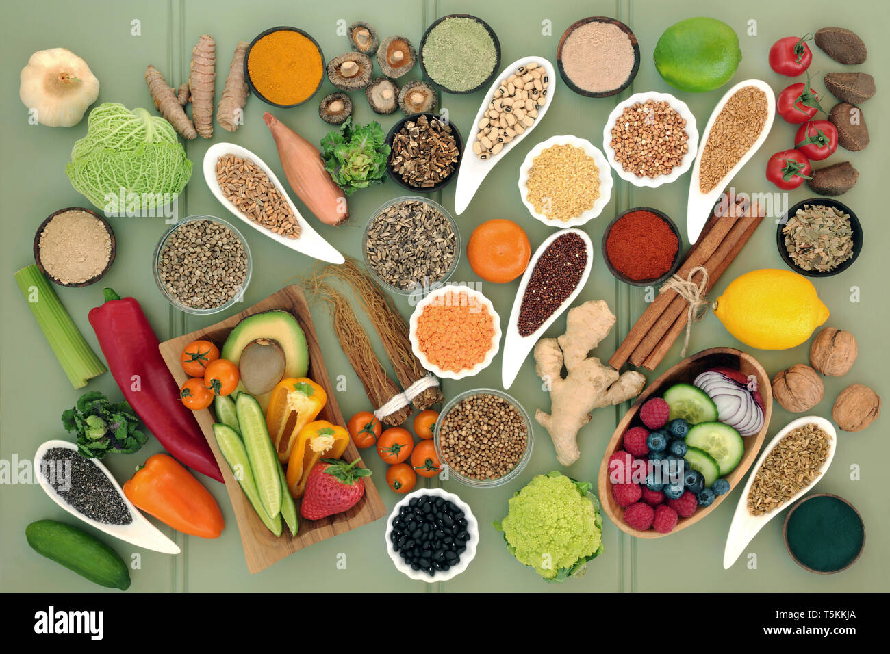 Healthy food for liver detox concept with fruit, vegetables, legumes, grains, seeds, herbs & spices used in herbal medicine & supplement powders. - Stock Image