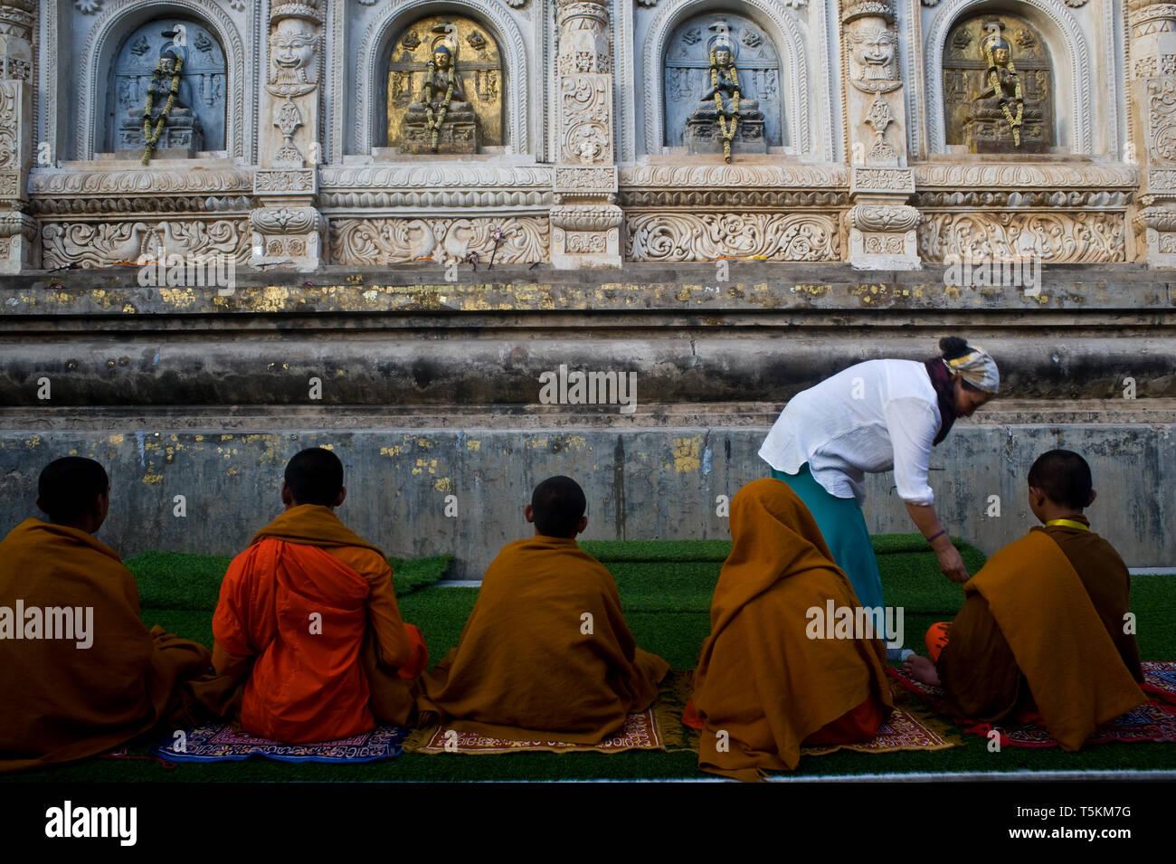 Buddhist boys are receiving alms at the Mahabodhi temple ( Bodhgaya, India) Stock Photo