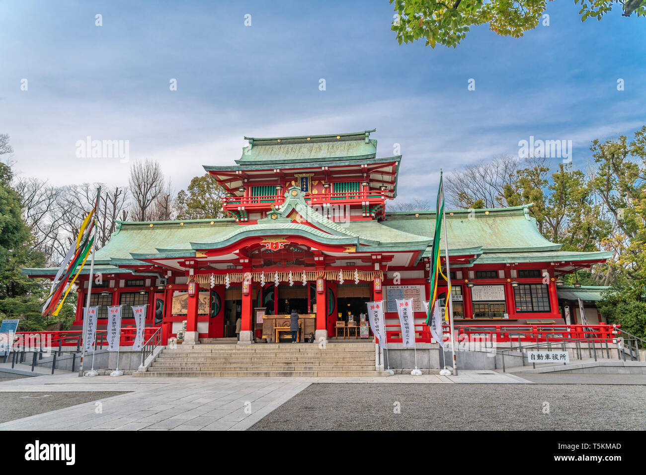 Tokyo, Japan - March 15, 2019 : Honden (Main Hall) of Tomioka Hachiman-gu Shinto Shrine. The largest shrine devoted to Hachiman deity in Tokyo - Stock Image