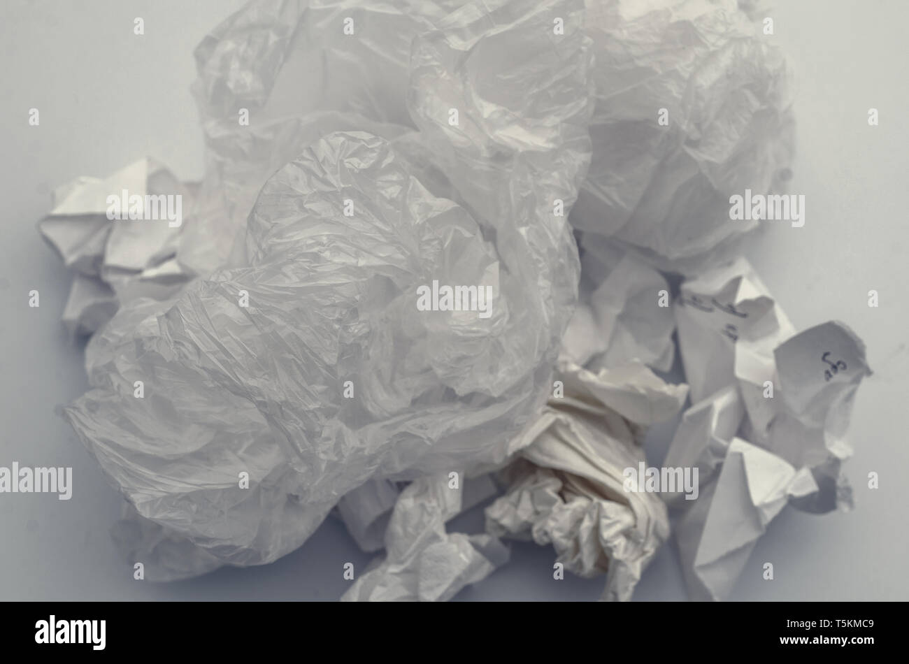 Crumpled sheets of paper, trash. Pollution, waste, ecology. - Stock Image