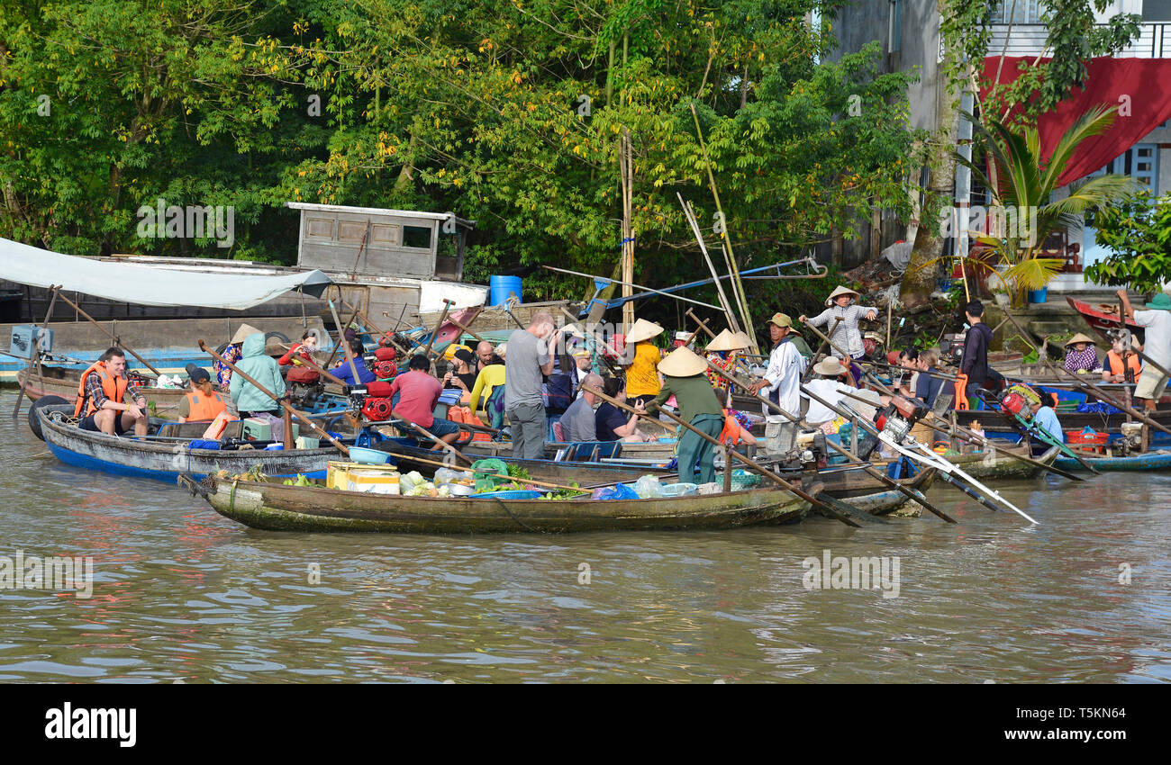 Phong Dien, Vietnam - December 31st 2017. Boats on the river at the Phong Dien Floating Market near Can Tho in the Mekong Delta. The boats are a mix o - Stock Image