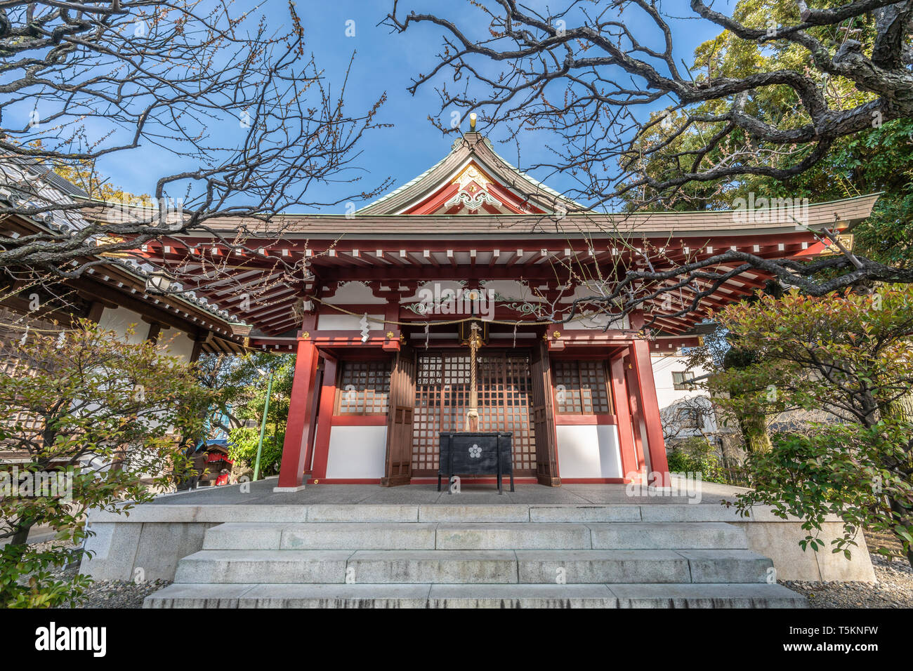 Tokyo, Japan - March 18, 2019 : Mitake Jinja built in 1669 in the precincts of   Kameido Tenjin Shinto Shrine. Devoted to U-no-Kami or Unokami Deity - Stock Image