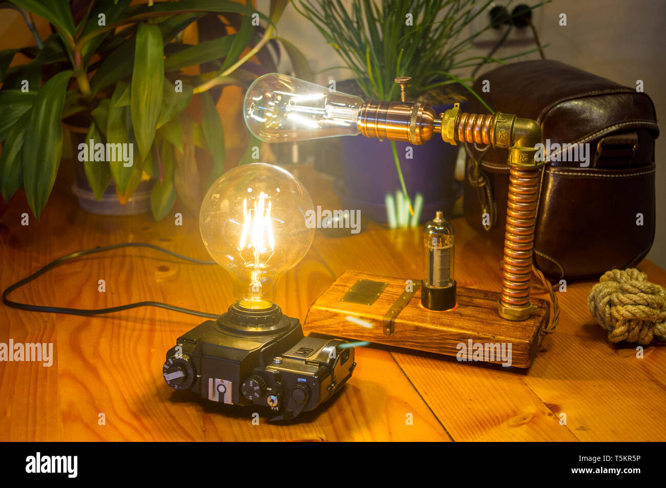 Light fixtures handmade in vintage style, retro film SLR camera case and wooden case, led lamps - Stock Image