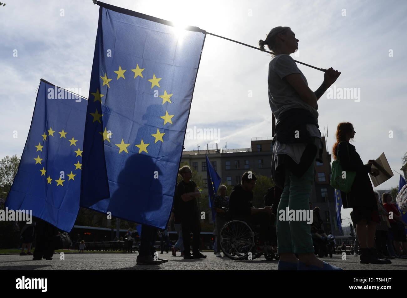 Prague, Czech Republic. 25th Apr, 2019. People hold European Union flags during a demonstration of group Against Signs of Hatred which took place at Namesti Miru Square, to be followed by a march to Wenceslas square to protest against the rally against 'dictate of the European Union' organised by Czech far-right Freedom and Direct Democracy party (SPD) at Wenceslas Square in Prague, Czech Republic, Thursday, April 25, 2019. Credit: Katerina Sulova/CTK Photo/Alamy Live News - Stock Image