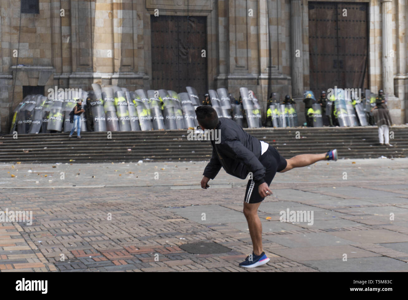 Bogota, Colombia. 25th Apr, 2019. April 25, 2019 - A hooded man throwing stones at the police in the march of the national strike in the city of Bogotà Credit: Daniel Garzon Herazo/ZUMA Wire/Alamy Live News Credit: ZUMA Press, Inc./Alamy Live News Stock Photo