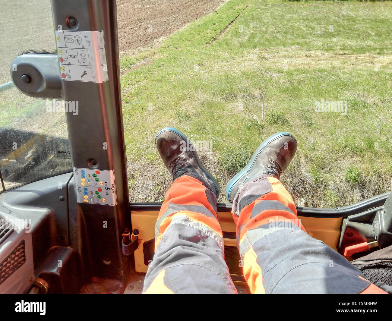 Sokobanja, Serbia - April 25, 2019: Worker rests his legs during the break while waiting to start rolling the roller in Sokobanja Serbia - Stock Image