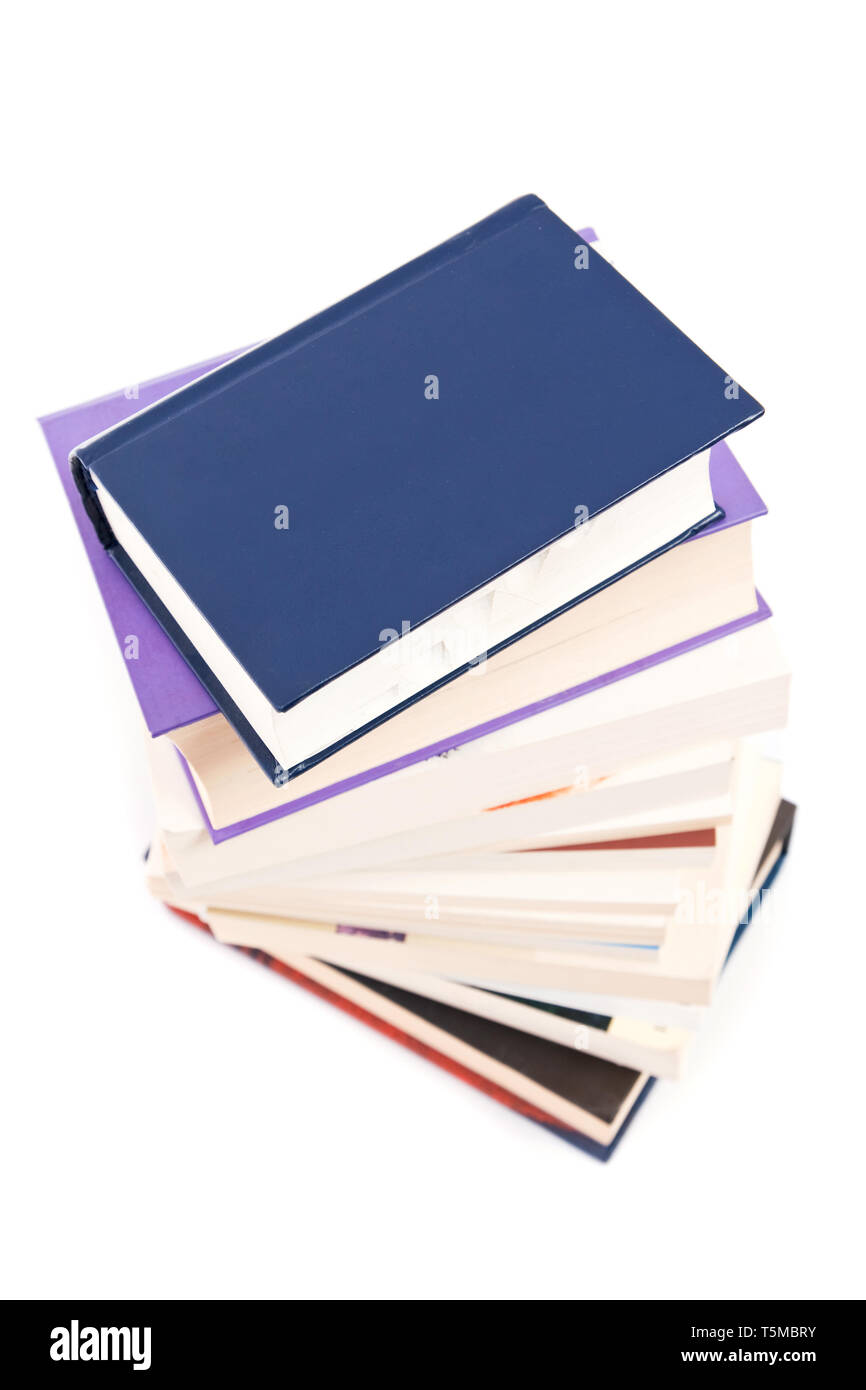 lots of colorful books together on white - Stock Image