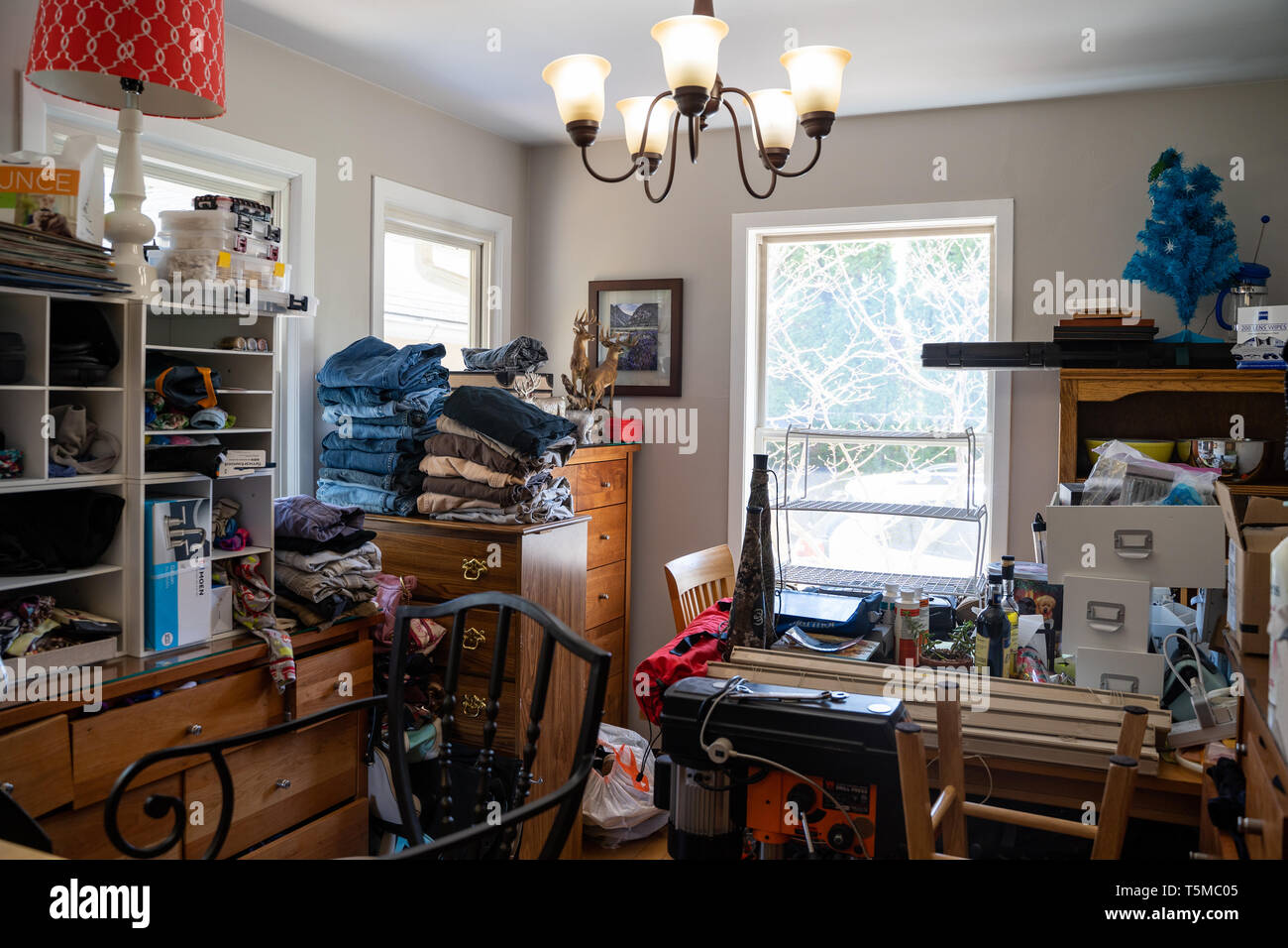 Minneapolis, Minnesota - April 24, 2019: Overcrowded residential kitchen in a home filled with junk. Concept for hoarding house, messy home, remodelin - Stock Image