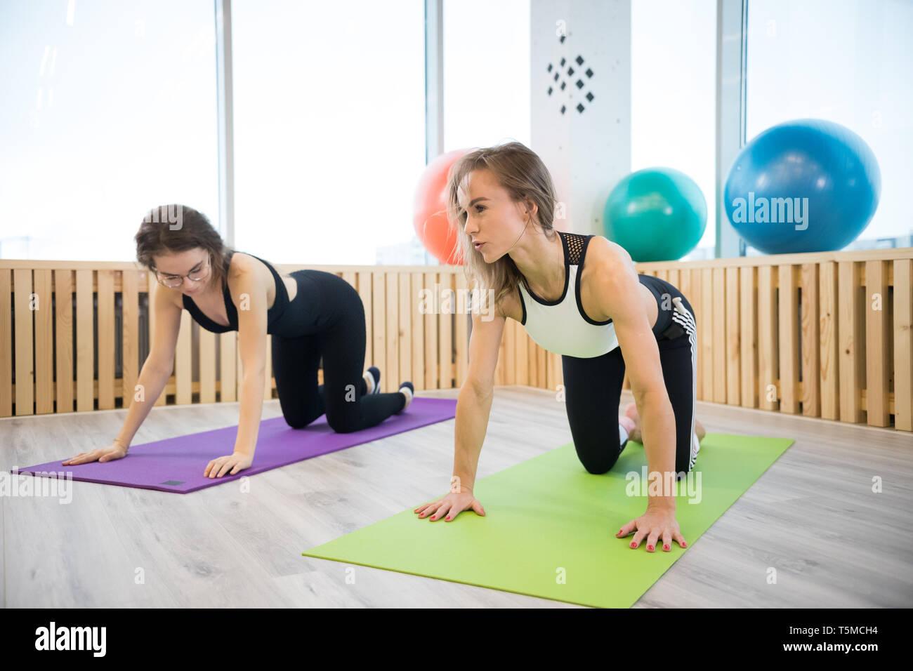 Young women doing yoga in the studio Stock Photo