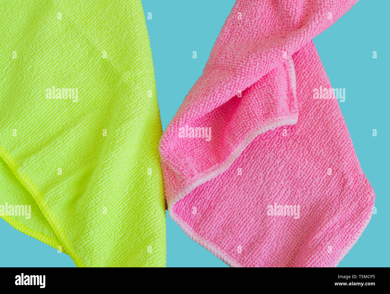 Microfiber cloths isolated on blue background, tools for cleaning and cleanliness. The concept of spring cleaning, flat lay. - Stock Image