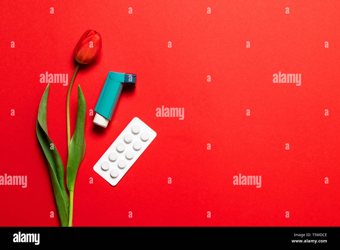 Composition of flowers and pills. Asthma, allergy to flowering plants - Stock Image