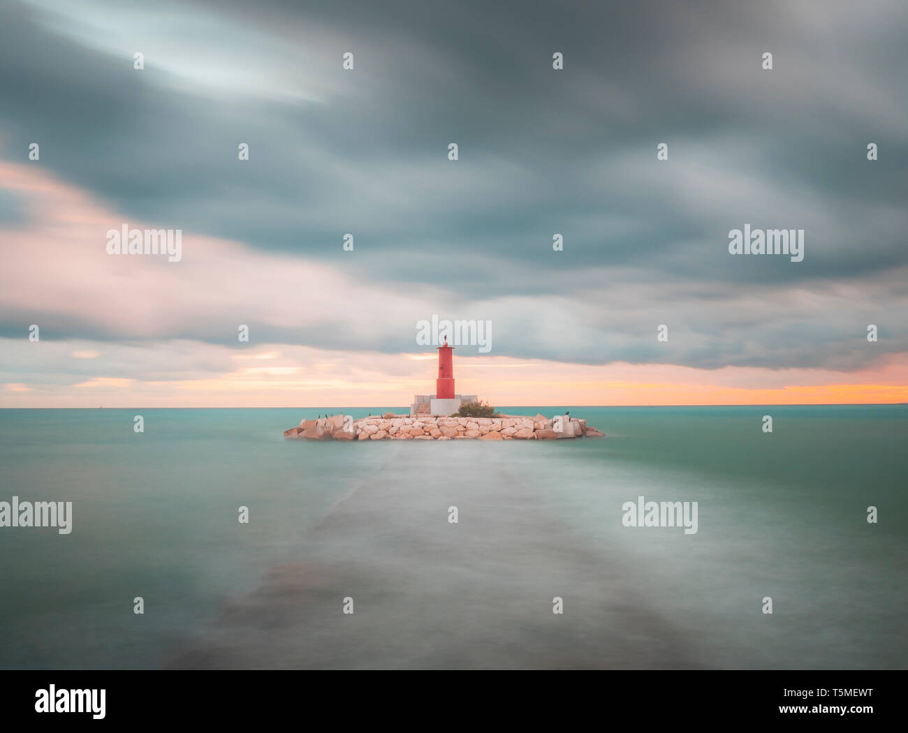 The lighthouse of Villajoyosa Alicante Spain in a cloudy day.Seascape - Stock Image