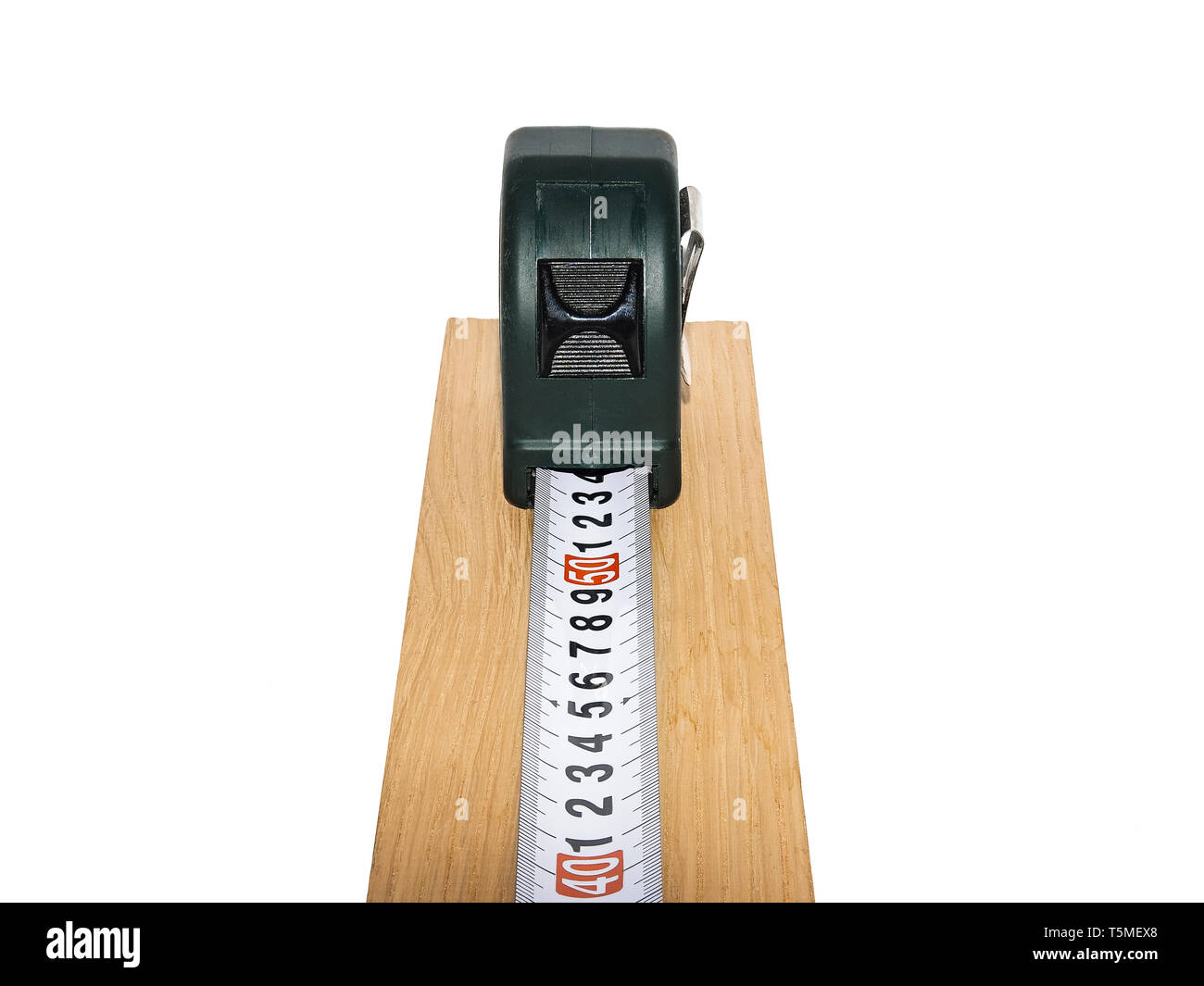 A tape measure on a piece of wood measuring between 49 cm and 50 cm. - Stock Image