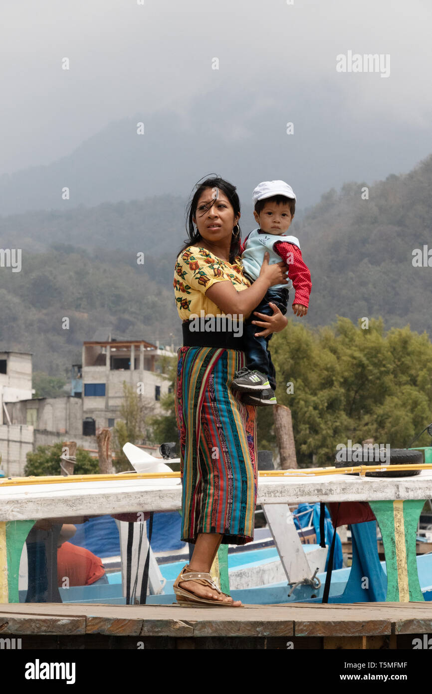 Guatemala people - a young mother and child on the jetty, Santiago Atitlan town; Guatemala Central America - Stock Image