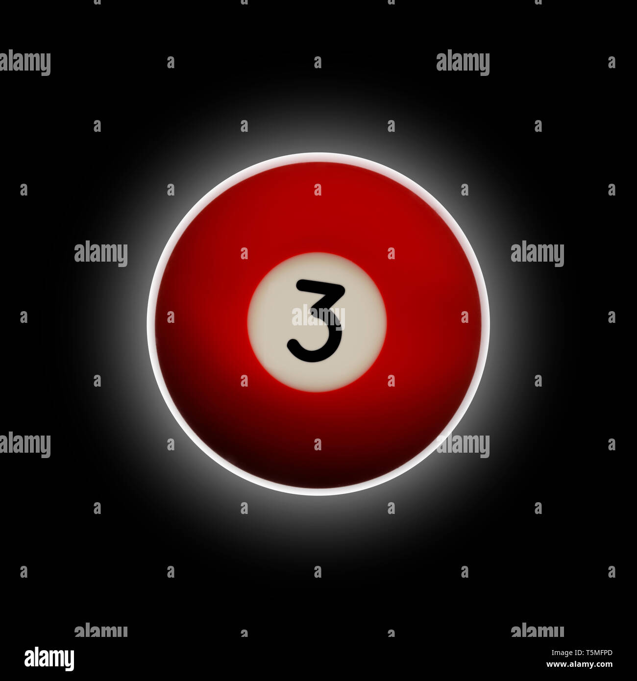 Red number 3 pool ball on a black background with halo effect behind it - Stock Image