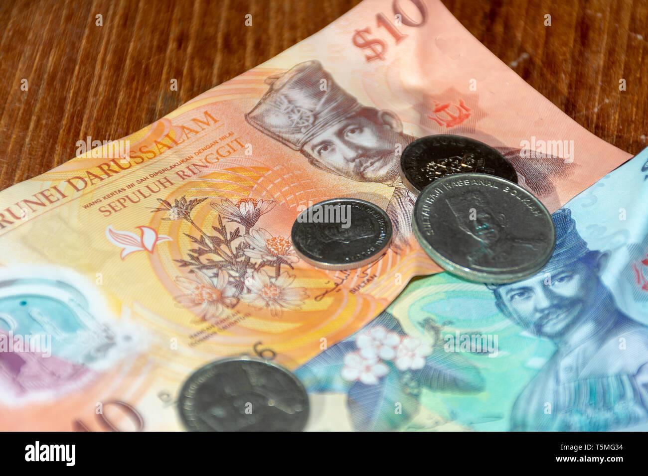 The dollar Currency of the Brunei Darussalem notes spread out on the table. Money exchange. - Stock Image