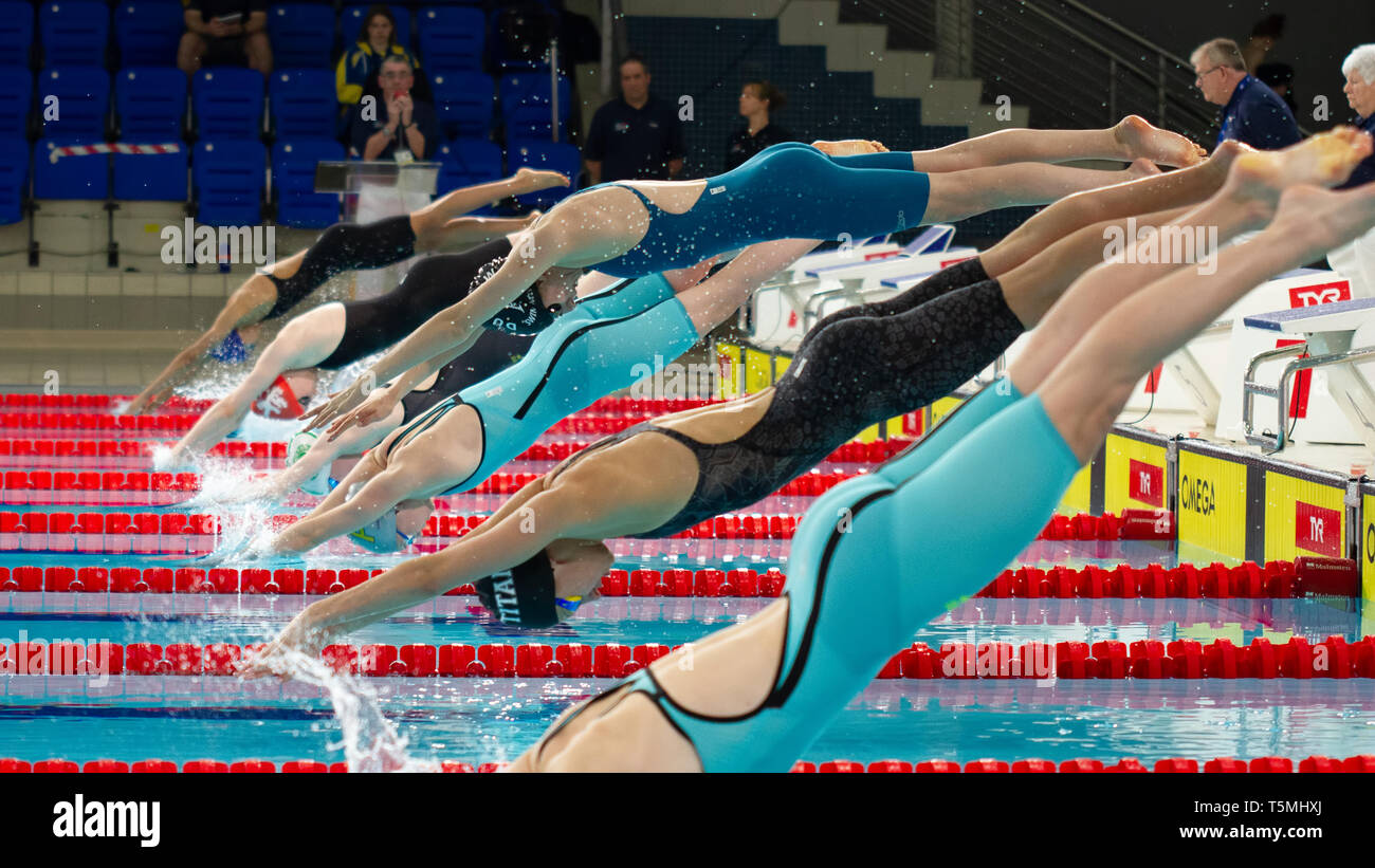 Swimmers begin the women's junior 50 metres freestyle final, during Day 3 of the 2019 British Swimming Championships, at Tollcross International Swimm - Stock Image