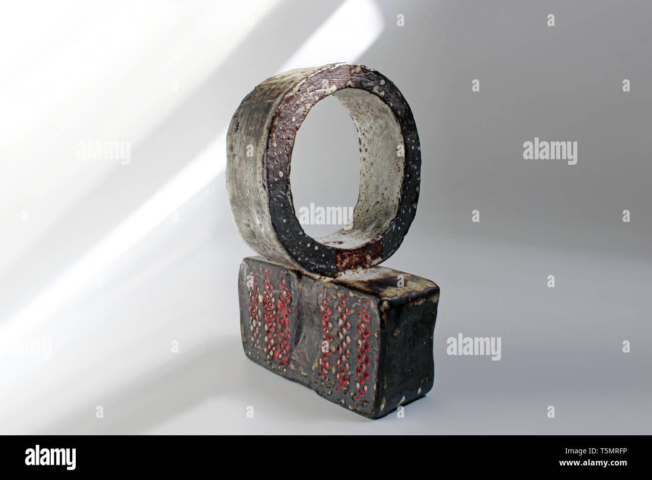 Shino Stoneware ceramics slipware with red porcelain, isolated on white background, close-up - Stock Image