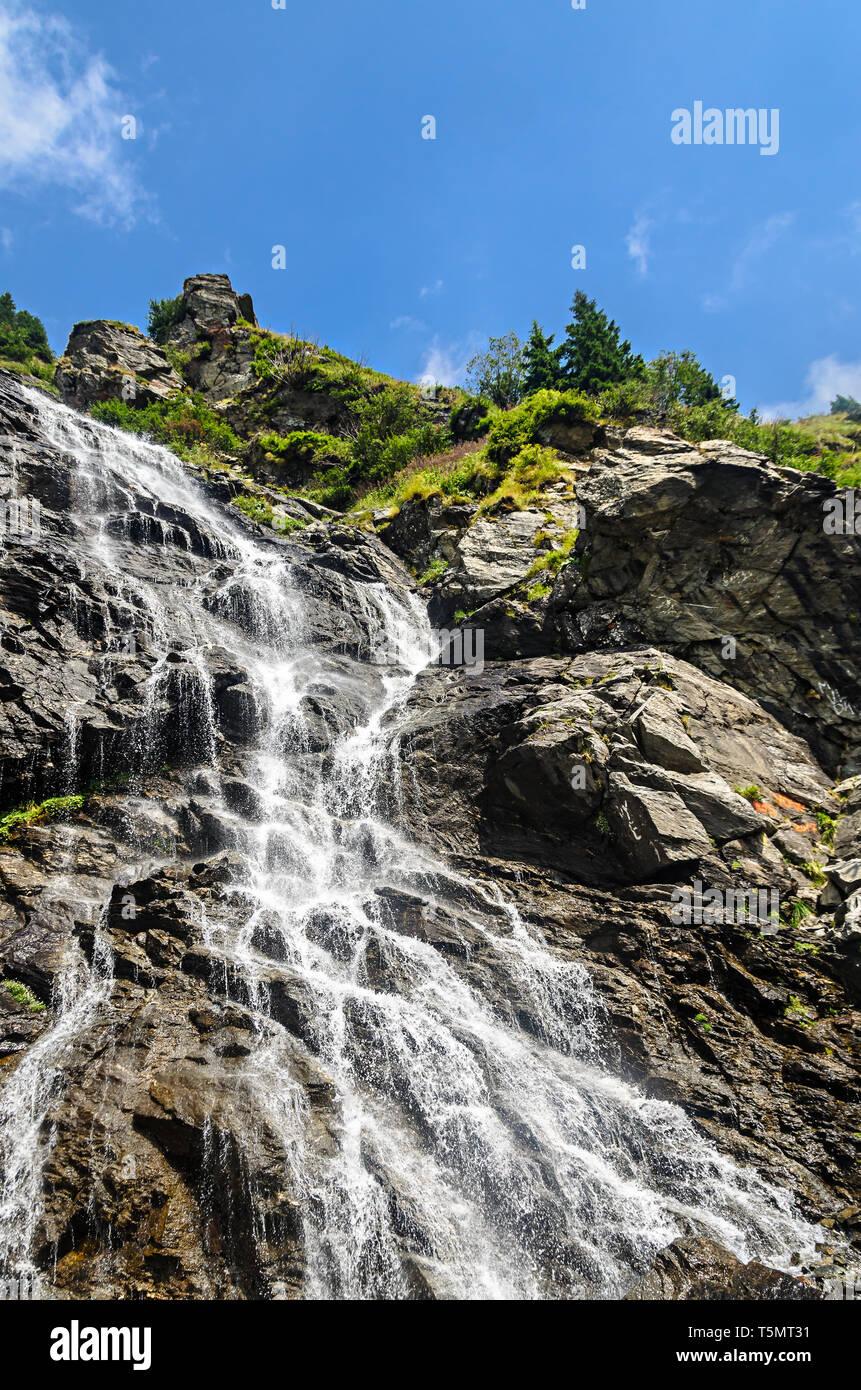 The waterfall called Balea on the Transfagarasan road from Fagaras mountains. Stock Photo