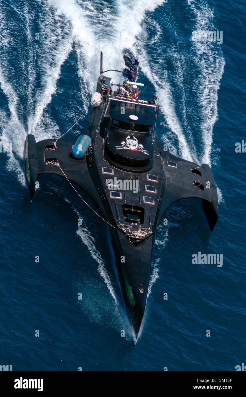 An elevated head on portrait view of the anti-whaling Sea Shepherd MV Gojira trimaran (now called MV Brigitte Bardot) at speed towards the camera. - Stock Image