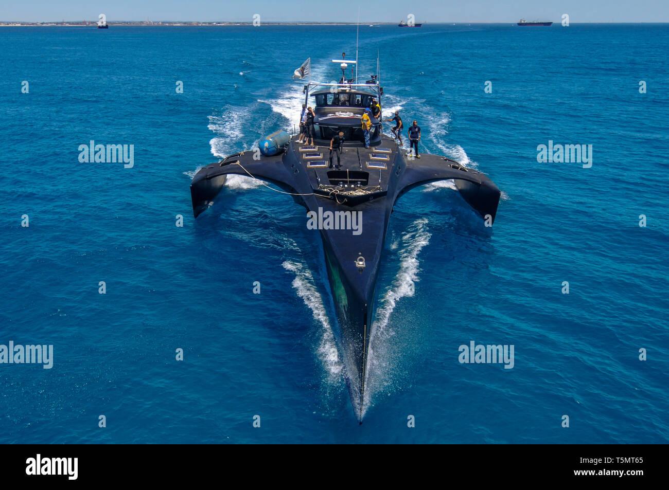 An elevated head on view of the anti-whaling Sea Shepherd MV Gojira trimaran (now called MV Brigitte Bardot) at speed towards the camera. - Stock Image