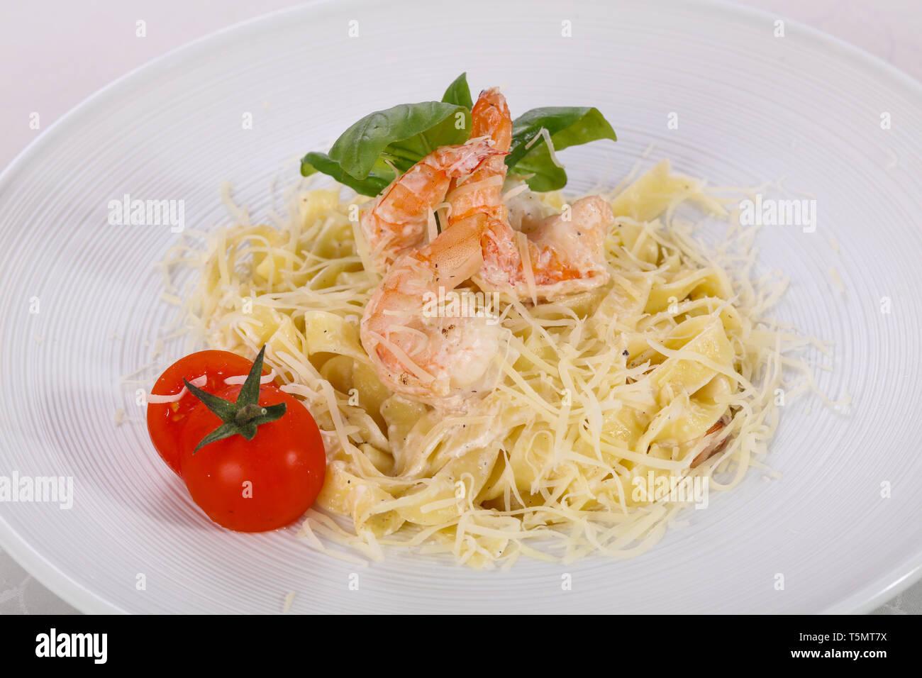 Italian pasta Linguini with prawns served basil Stock Photo