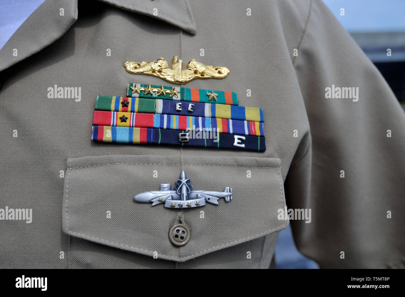 Close up of a naval officers uniform, with emblem & decorations on the nuclear-powered fleet ballistic missile submarine USS Ohio (SSBN-726/SSGN-726). - Stock Image