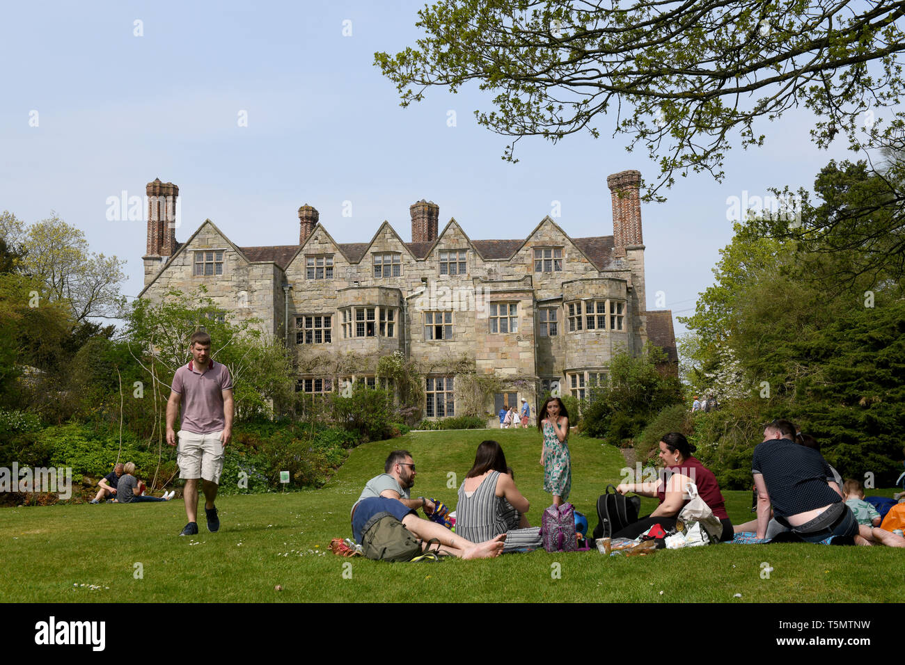 People having a picnic in front of Benthall Hall, Shropshire, England. - Stock Image