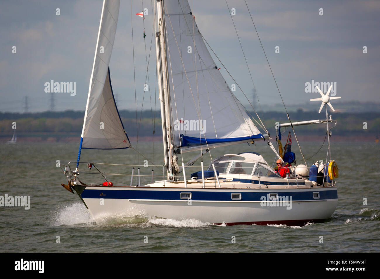 Hallberg-Rassy 352, Yacht, cruising,cruiser,sailing,yachting,retired,couple,roller,reefing,jib, mainsail,sail,long,distance,voyage,holiday,The Solent, - Stock Image