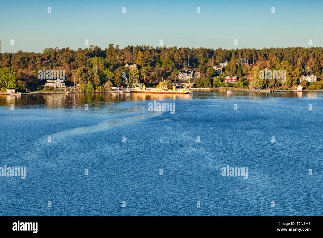 View of an island in the Stockholm Archipelago, Sweden, from a cruise liner. - Stock Image