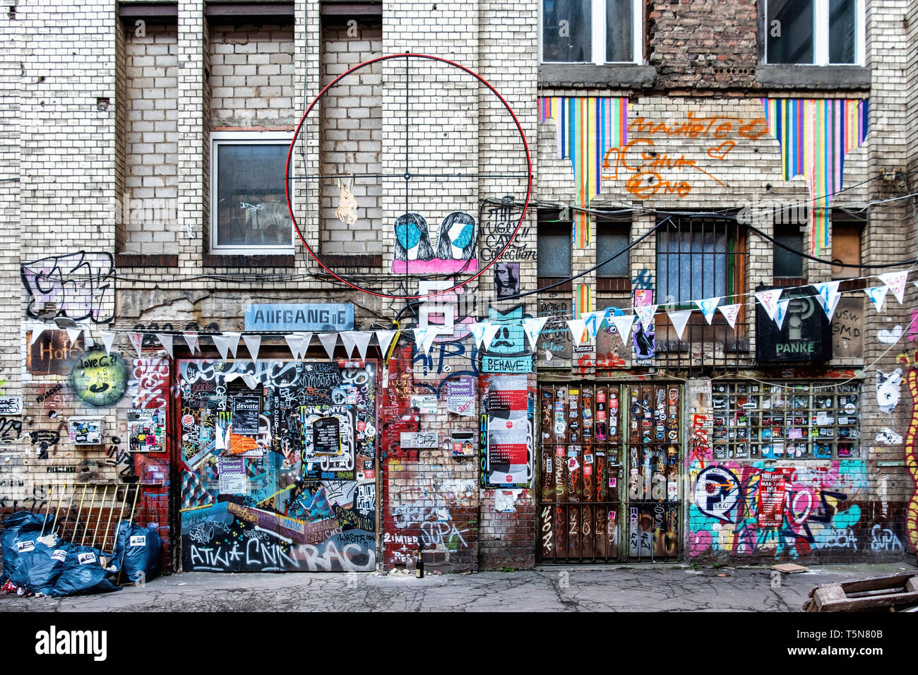 Wedding, Berlin. Inner courtyard of dilapidated old industrial building next to Panke river at Gerichtstrasse 23. Residential & business use. Stock Photo