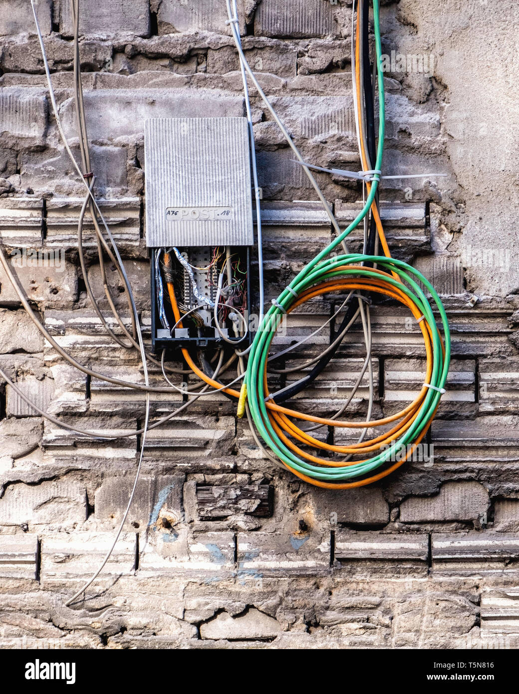 Wedding, Berlin.Electric wiring in Inner courtyard of dilapidated old industrial building next to Panke river at Gerichtstrasse 23.Building detail. Stock Photo