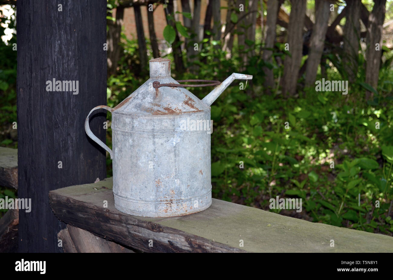 Ancient metal canister used for storing drinks - Stock Image