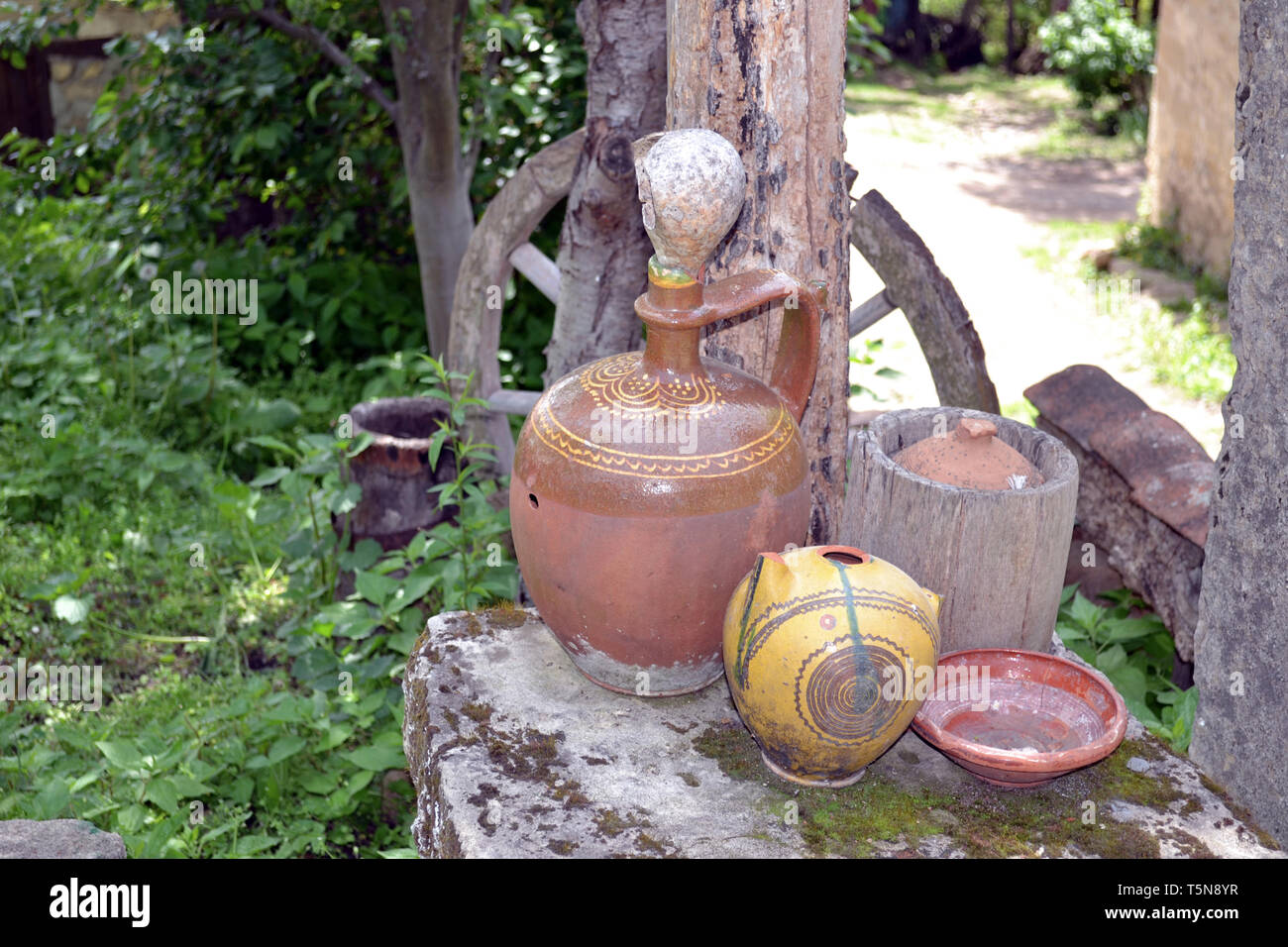 Antique clay pots used for storing food and drink - Stock Image
