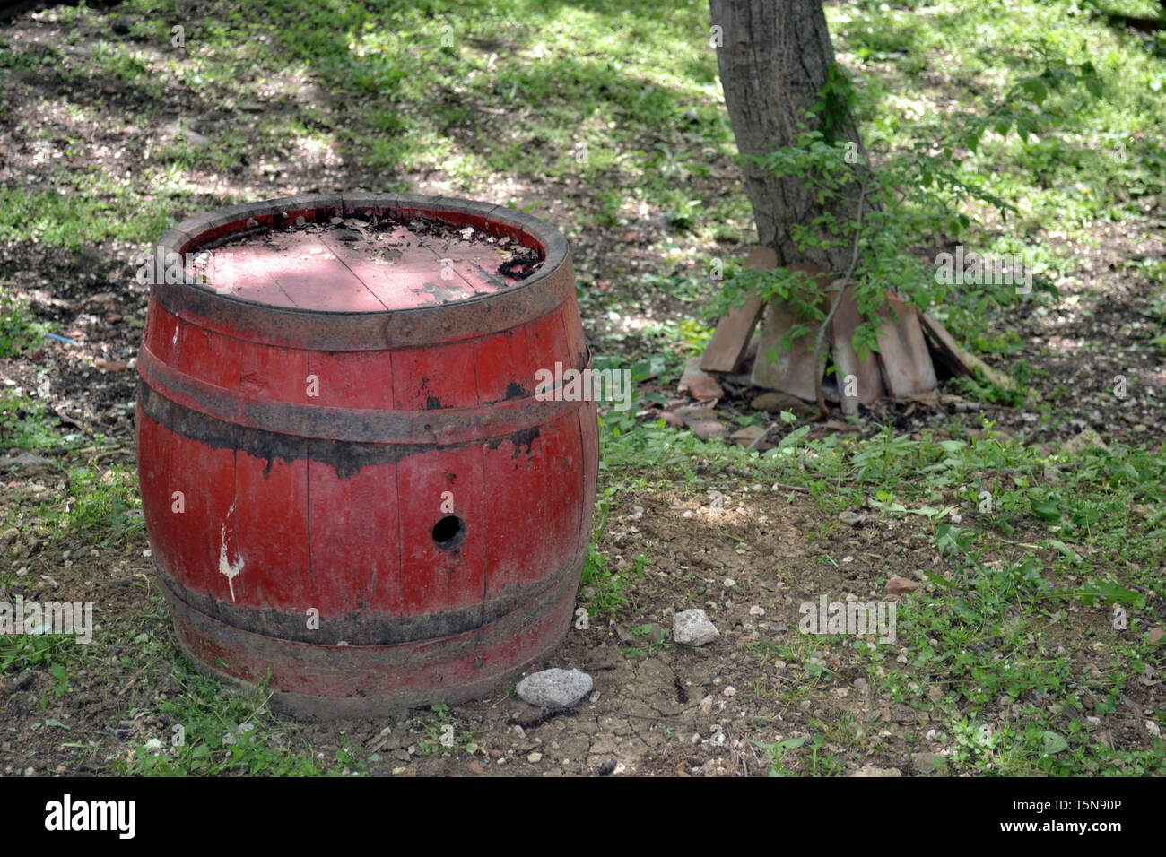Ancient red barrel used for storing vine in rural part of the country - Stock Image