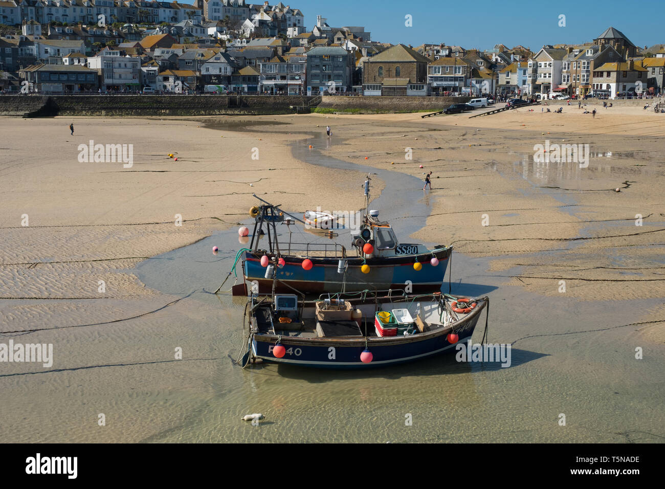 Fishing boats at low tide, St Ives harbour, Cornwall, England Stock Photo