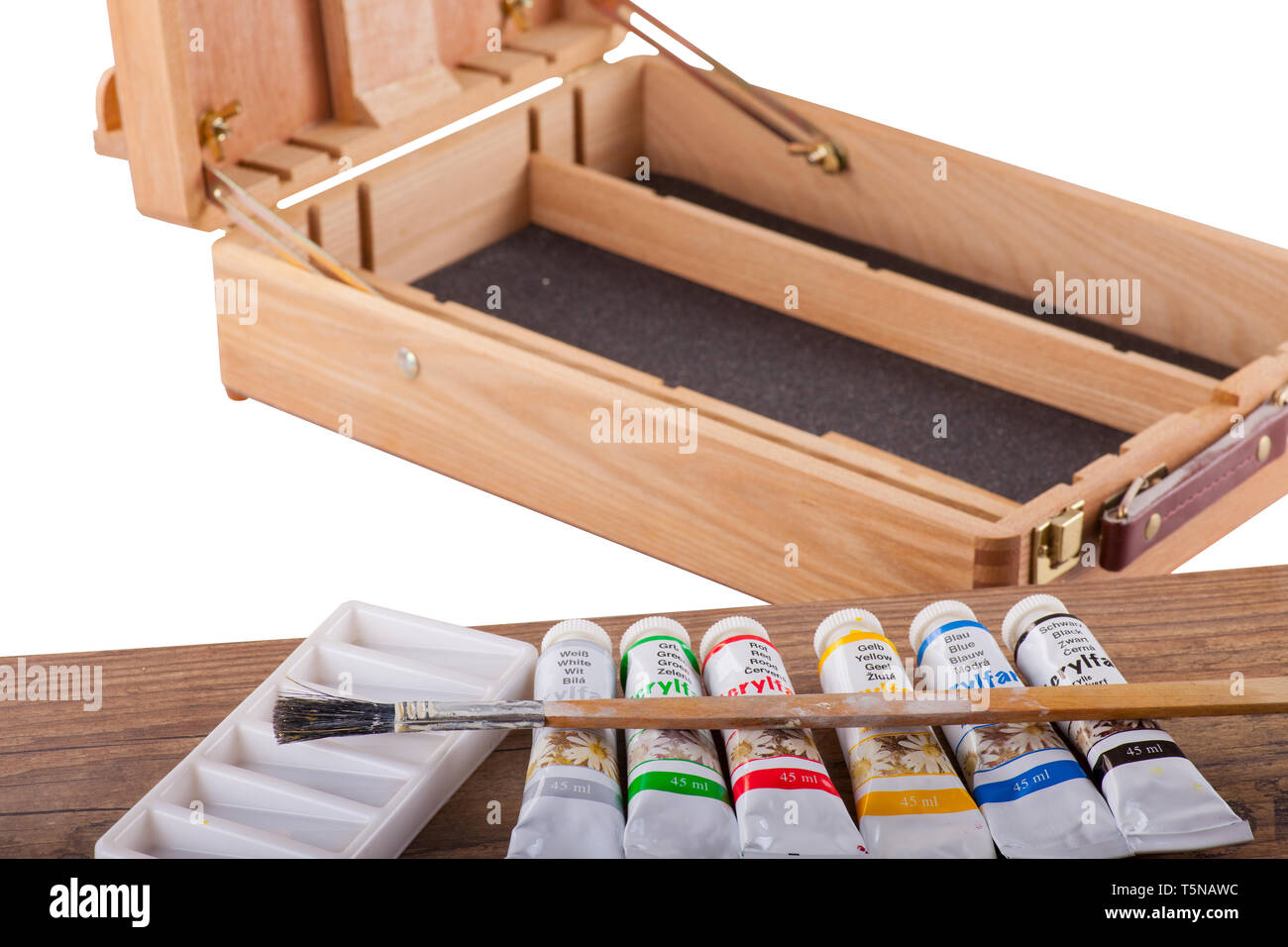 Acrylic paints on an easel - isolated on a white background - Stock Image
