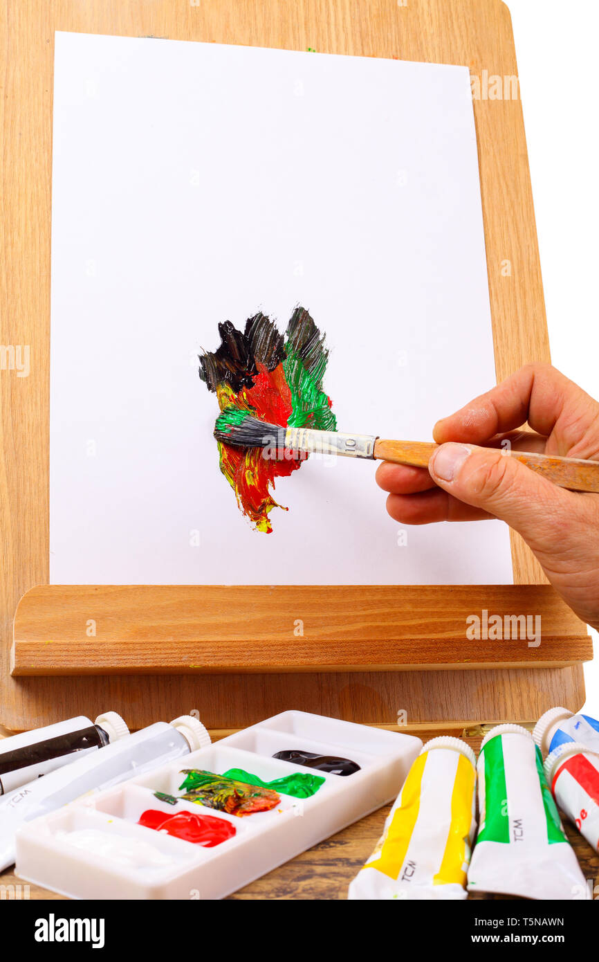Hand painted on an easel - isolated on a white background - Stock Image