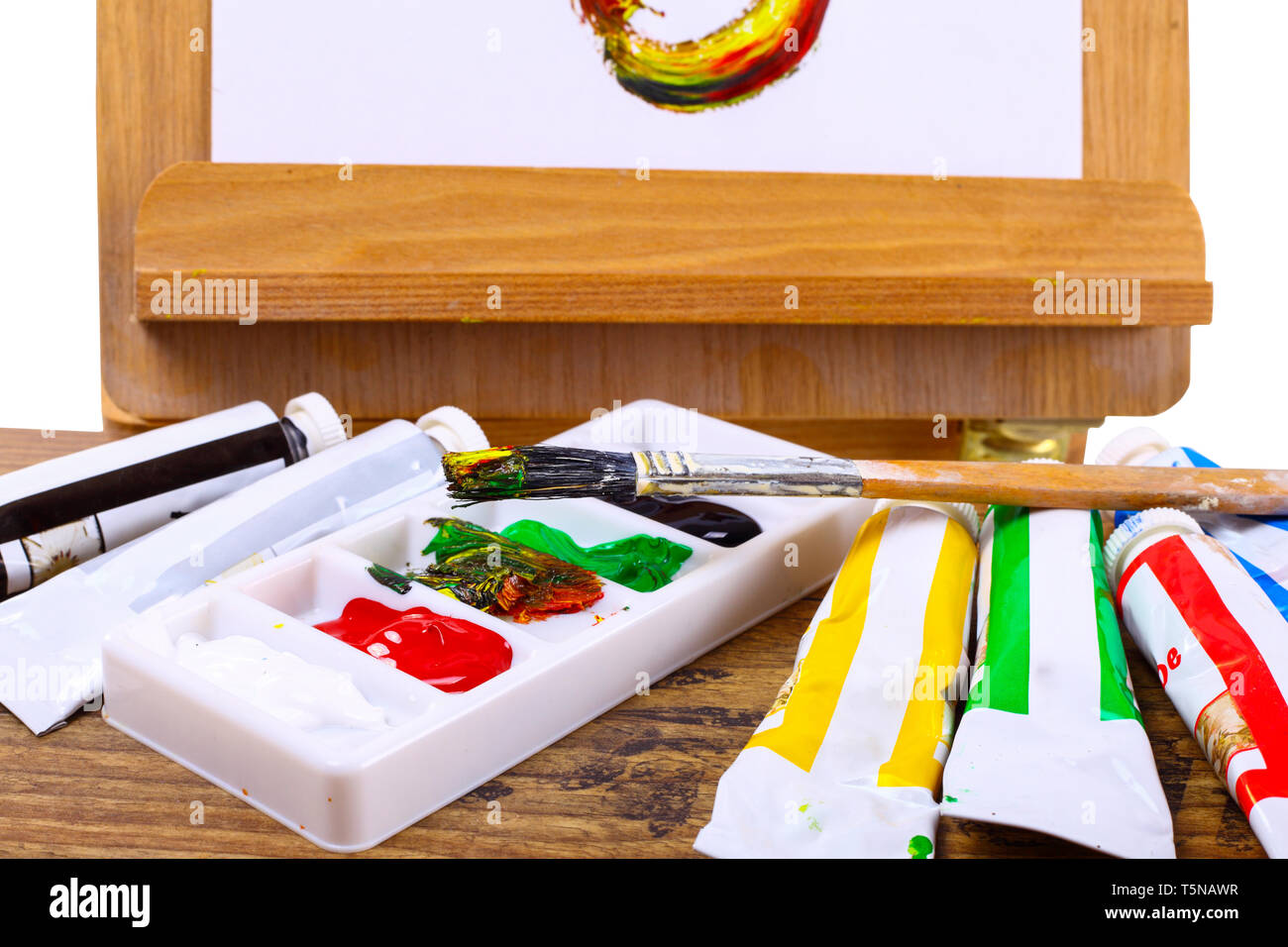 Acrylic paints on an easel - isolated on a white backgrond - Stock Image