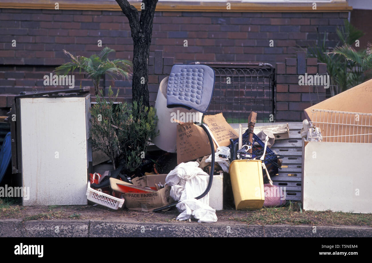 RUBBISH PILED UP OUTSIDE A SYDNEY HOME READY FOR THE COUNCIL'S HARD RUBBISH CLEAN-UP, NEW SOUTH WALES, AUSTRALIA. - Stock Image