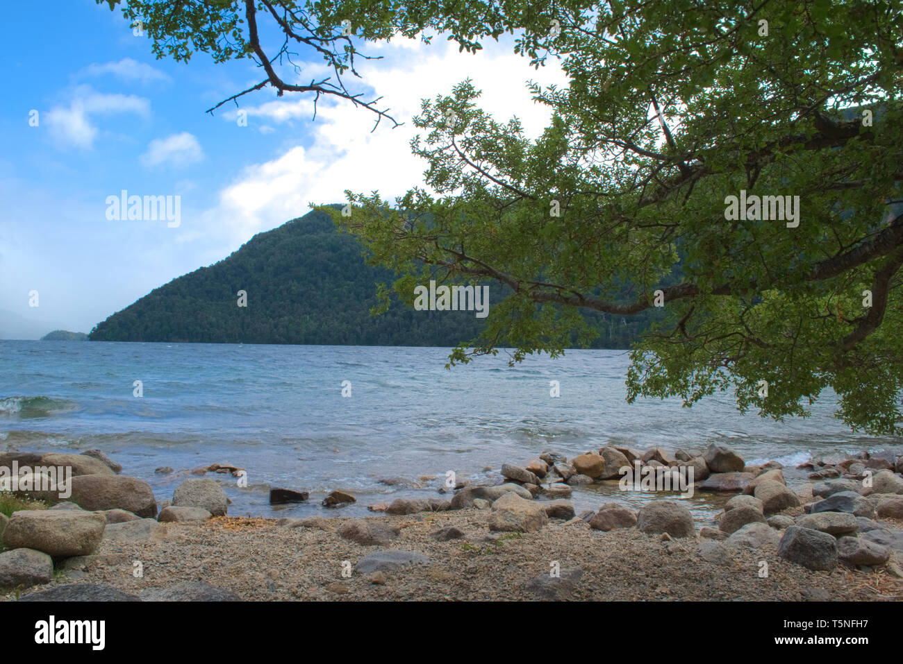 An idyllic view by the shore of Lago Hermoso (Lake Beautiful) in the Nahuel Huapi national park, Argentinian Patagonia. - Stock Image