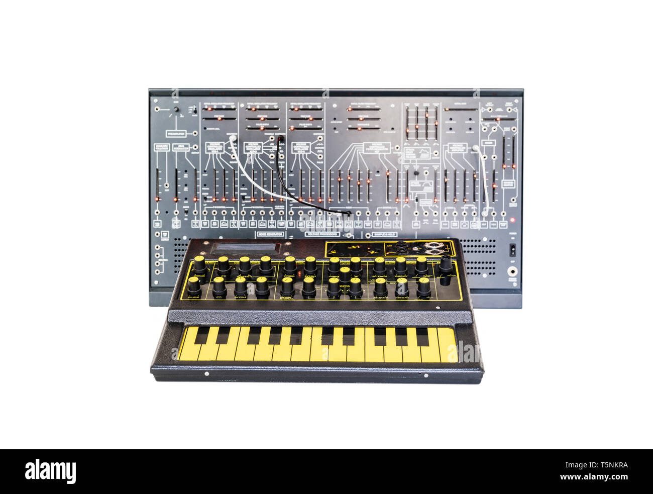 Two Synthesizers. EDP Wasp from 1978 and a modern clone of the Arp 2600 from 1971 with patch cables, in an analog music recording studio. - Stock Image