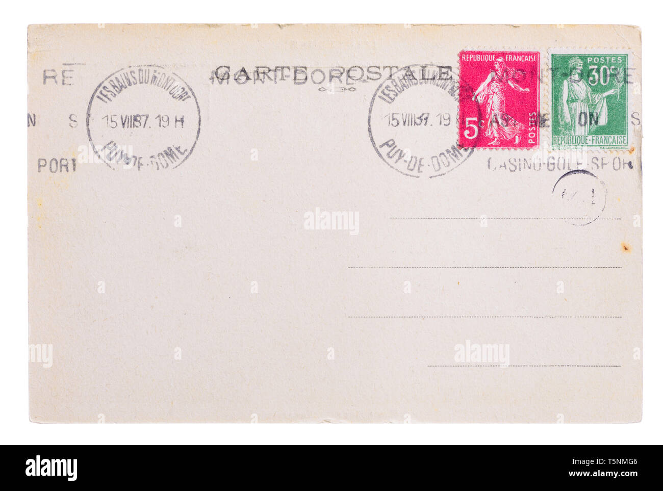 Vintage yellowed postcard back side, circa 1937, with old french post and meter stamps, with text Postcard and name of french village Mont Dore, isola - Stock Image