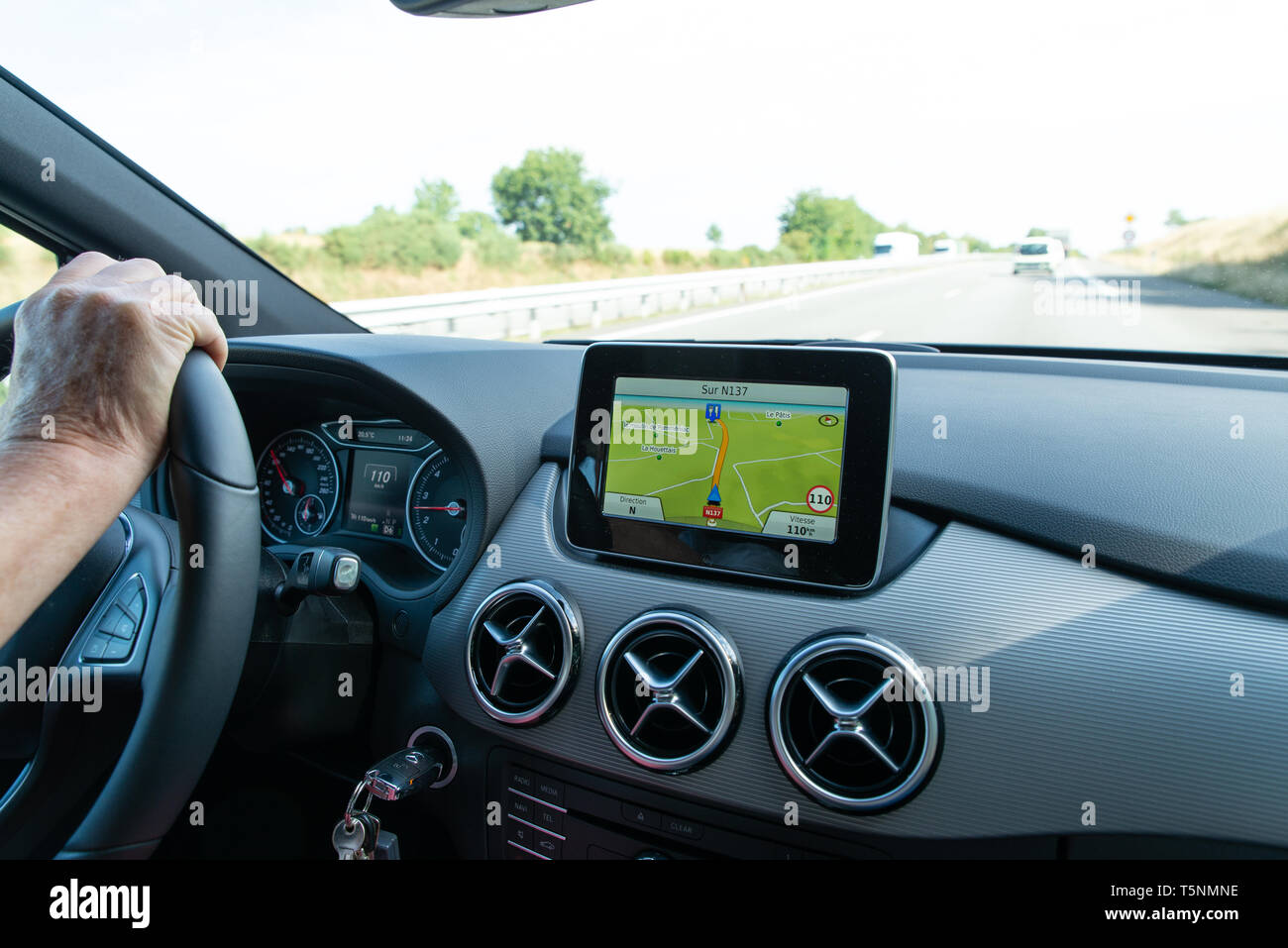 GPS unit in a Mercedes on  road in France. - Stock Image